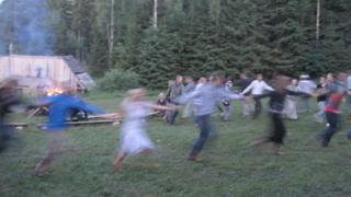 People dance around a bonfire in Estonia