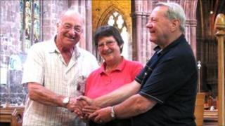Eric and Margaret with Ken the welcomer at St Mary's in Nantwich