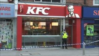 A police officer outside KFC in Portswood
