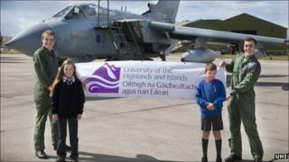 The Tornado crew and local schoolchildren with a UHI banner