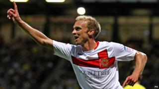 MK Dons' Luke Chadwick celebrates scoring a goal against Norwich in their Carling Cup win