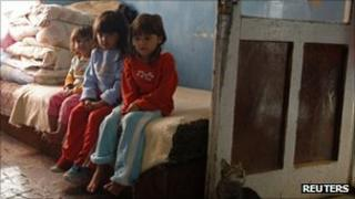 Roma children in their home in Alsozsolca, north of Budapest, Hungary