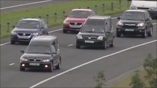 Hearses carrying victims' bodies