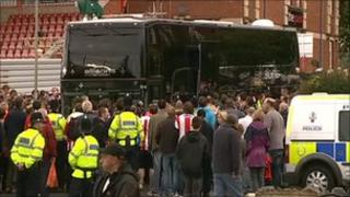 Bus, police and fans at St James Park