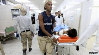 An injured rebel fighter is attended to in Al-Galah hospital in Benghazi