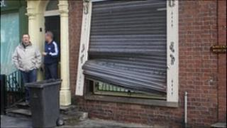 Damage to the shutters of a business in Manchester's Northern Quarter