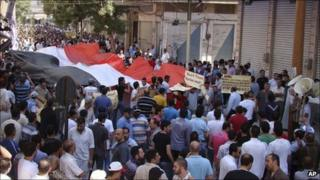 A mobile phone image distributed by Syrian activists said to show an anti-government protest in Homs - 26 August 2011