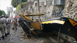 Firefighters survey the wreckage of a tram in Rio on 27 August 2011