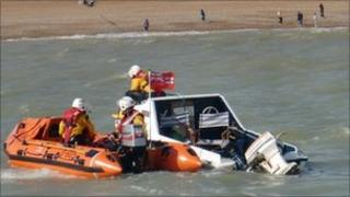 RNLI towing the vessel back to shore