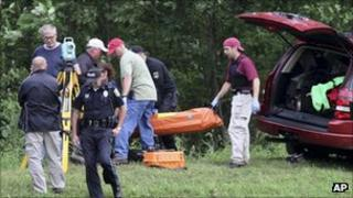 Authorities take Egland's body out of the woods