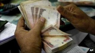 Man counting rupees in Bangalore