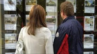 Potential homebuyers looking in to estate agent