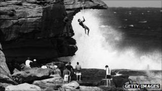 Bare-handed rope climbing on Bondi beach, Australia