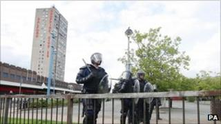 Riot police in front of Salford Shopping City