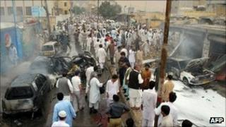 Residents gather at the site of a car bomb blast in Quetta on 31 August 2011