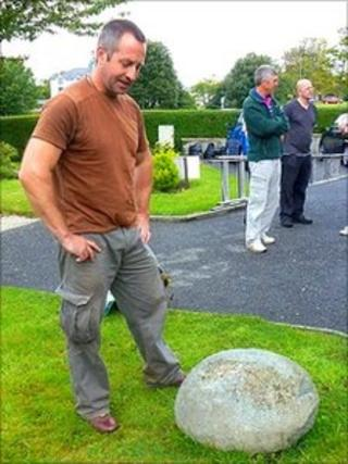 Roger Davis mulling over the 'feat stone' in Criccieth