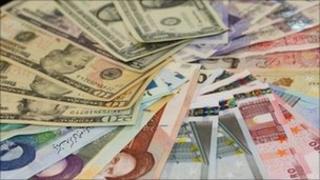 Various currencies: Iranian Persian rial rials, US dollars, Euros, British pound sterling