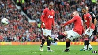 Wayne Rooney scores from a free-kick against Arsenal