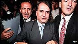 Alberto Santofimio (centre) is taken into custody in 1995
