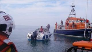 Motorboat being rescued
