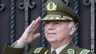 """Chile""""s Police General Director Eduardo Gordon, right, salutes after his resignation, 2 September 2011"""