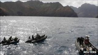 Rescue workers search remains of the plane that crashed near Juan Fernandez islands, about 420 miles (670 km) off Chile's coast, 4 September 2011