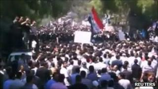 Anti-government protesters take part in a funeral in Idlib for four residents killed on 2 September 2011 in this still image taken from a video posted on 3 September 2011 on a social media website. Reuters is unable to independently verify the contents of the image.