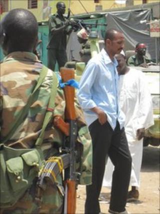 soldier with gun at market