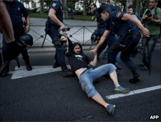 Police detain a protester in Madrid, 2 September