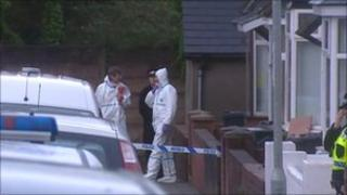 Forensic experts at the scene of the murder in Pontnewydd, Cwmbran