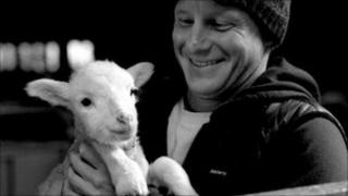 Tom Kay with a Bowmont lamb