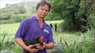 Geoff George holding a chicken