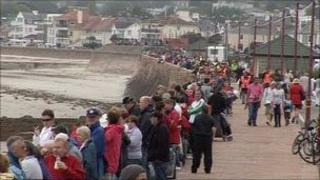 People wearing red for the Red Arrows in Jersey