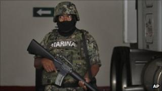 A member of the Mexican navy with telecoms gear of the Zetas drug cartel in Veracruz, Mexico, Thursday 8 Sept