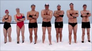 Swimmers stand in the snow on Brighton beach in December 2010