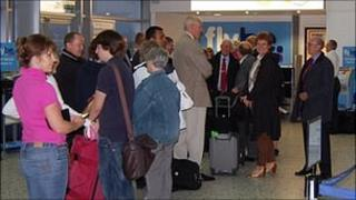 Passengers queuing to sort out accommodation or change flights at Guernsey Airport