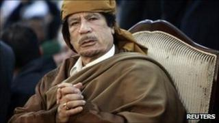 Libyan leader Muammar Gaddafi attends a ceremony marking the birth of Islam's Prophet Mohammed in Tripoli, in this February 13, 2011