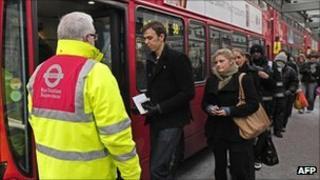 Passengers board a London bus