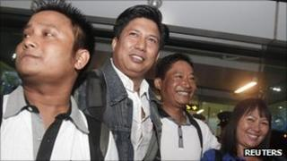 Members of the Thee Lay Thee troupe arrive at Rangoon airport on Sunday 11th September 2011