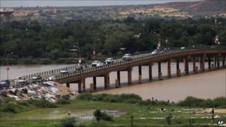 Cars cross a bridge in Niamey, Niger, Monday 12 September 2011