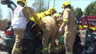 Firemen taking part in road safety drill