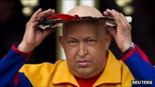 President Hugo Chavez wearing a feathered indigenous head dress