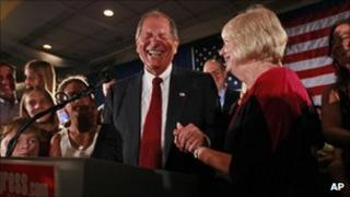 Bob Turner, centre, joined by his wife Peggy, right, and family smiles as he delivers his victory speech during an election night party, New York, Sept 14 2011