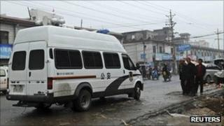 Police van at the scene of the attack in Gyongi on 14 September 2011