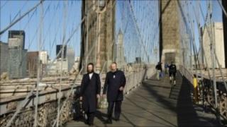 Orthodox Jews cross the Brooklyn Bridge