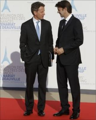US treasury secretary Tim Geithner talks with French finance minister Francois Baroin