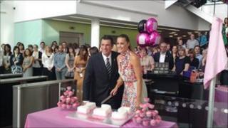Yasmin Le Bon and Scott Schlackmann cutting the celebratory cake.