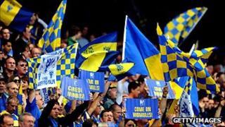 AFC Wimbledon supporters cheer on their team