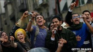 Young men and women protest in Cairo