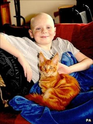 Henry Dancer and Ben the cat. Photo: PA